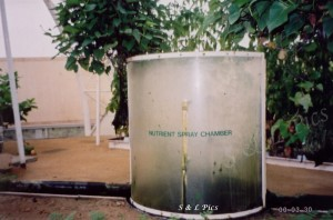 Nutrient chamber where roots are sprayed with nutrient as they pass through.